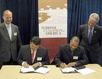 Congressman Michael McMahon (D-NY-13th) and Lincoln McCurdy witness MOU signing by Dr. Burak Kuntay of Bahcesehir and Mr. Michael Hester of UNCFSP.