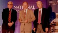 TCA President G. Lincoln McCurdy (center), representing ACEV, receives the 2014 International Prize from David M. Rubenstein (left), Co-Chair of the Book Festival, and Librarian of Congress James H. Billington (right).