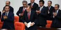 Ministers applaud Turkish Prime Minister Recep Tayyip Erdoğan, front, at the Parliament in Ankara on Wednesday, April 23. (Photo: AP)